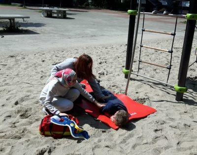 Verletzung im Sand